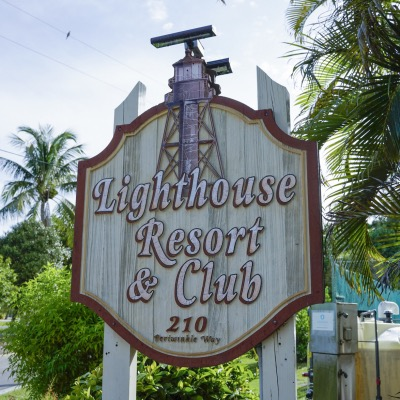 Lighthouse Resort & Club Road Sign