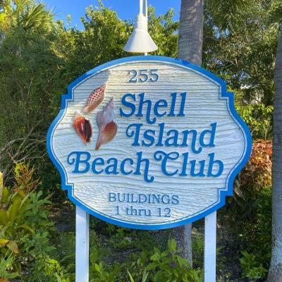 Shell Island Beach Club Road Sign